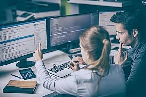 computer programmers assessing network vulnerabilities to practice Zero Trust